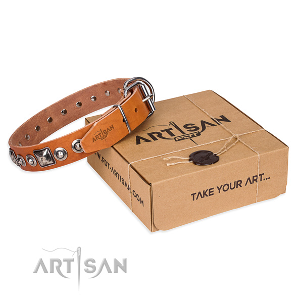 Genuine leather dog collar made of gentle to touch material with rust-proof buckle